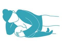 Breastfeeding positions. Reclining position.